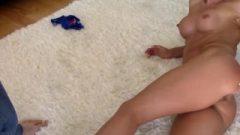 Suggestive Brunette Spanked On The Floor