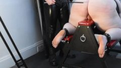 Fat Redhead In Latex On Spanking Bench Doing Impact Play